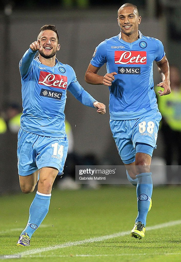 <a gi-track='captionPersonalityLinkClicked' href=/galleries/search?phrase=Dries+Mertens&family=editorial&specificpeople=6524919 ng-click='$event.stopPropagation()'>Dries Mertens</a> (L) of SSC Napoli celebrates after scoring their second goal during the Serie A match between ACF Fiorentina and SSC Napoli at Stadio Artemio Franchi on October 30, 2013 in Florence, Italy.