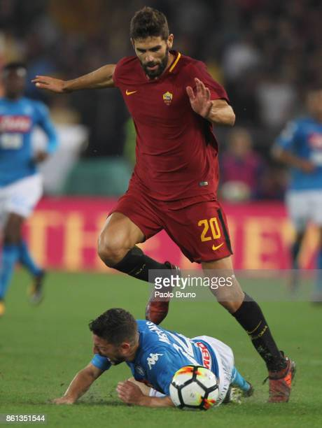 Dries Mertens of SSC Napoli competes for the ball with Federico Fazio of AS Roma during the Serie A match between AS Roma and SSC Napoli at Stadio...