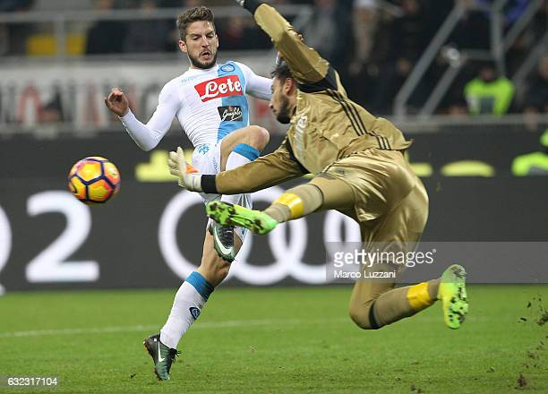 Dries Mertens of SSC Napoli is challenged by Gianluigi Donnarumma of AC Milan during the Serie A match between AC Milan and SSC Napoli at Stadio...