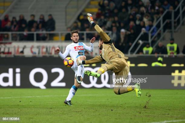 Dries Mertens of SSC Napoli is challenged by Gianluigi Donnarumma of AC Milan during the Serie A match between AC Milan and SSC Napoli SSC Napoli...