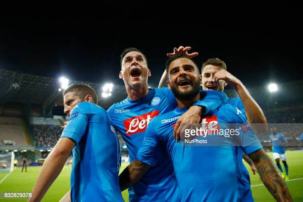 Dries Mertens with Jose Maria Callejon and Lorenzo Insigne of Napoli celebrating after the goal of 10 during the UEFA Champions League Play Off first...