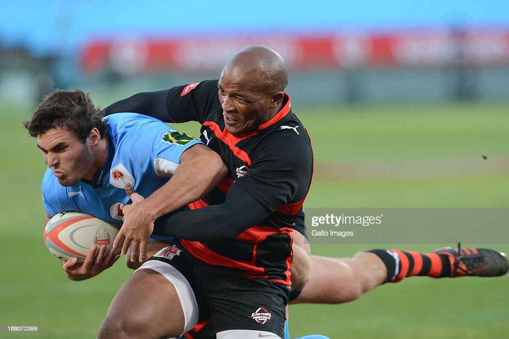 Dries Swanepoel of Blue Bulls tackled by Siyabonda Mangweni of Eastern Province Kings during the Vodacom Cup Quarter Final match between Vodacom Blue...