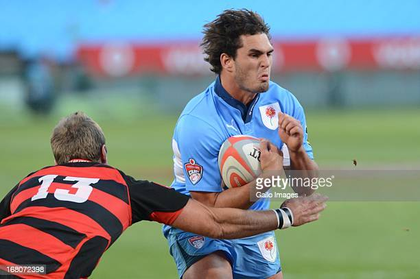 Dries Swanepoel of Blue Bulls tackled by Wayne Stevens of Eastern Province Kings during the Vodacom Cup Quarter Final match between Vodacom Blue...