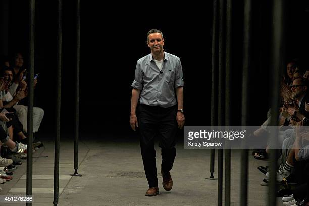 Dries Van Noten acknowledges the audience during the Dries Van Noten show as part of Paris Fashion Week Menswear Spring/Summer 2015 on June 26 2014...