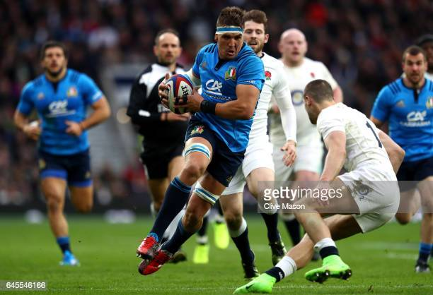 Dries van Schalkwyk of Italy is challenged by Jonny May of England during the RBS Six Nations match between England and Italy at Twickenham Stadium...