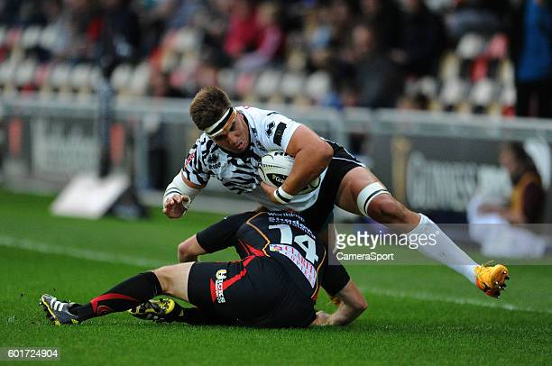 Dries van Schalkwyk of Zebre is tackled by Adam Warren of Dragons during the Guinness PRO12 Round 2 match between Newport Gwent Dragons and Zebre...