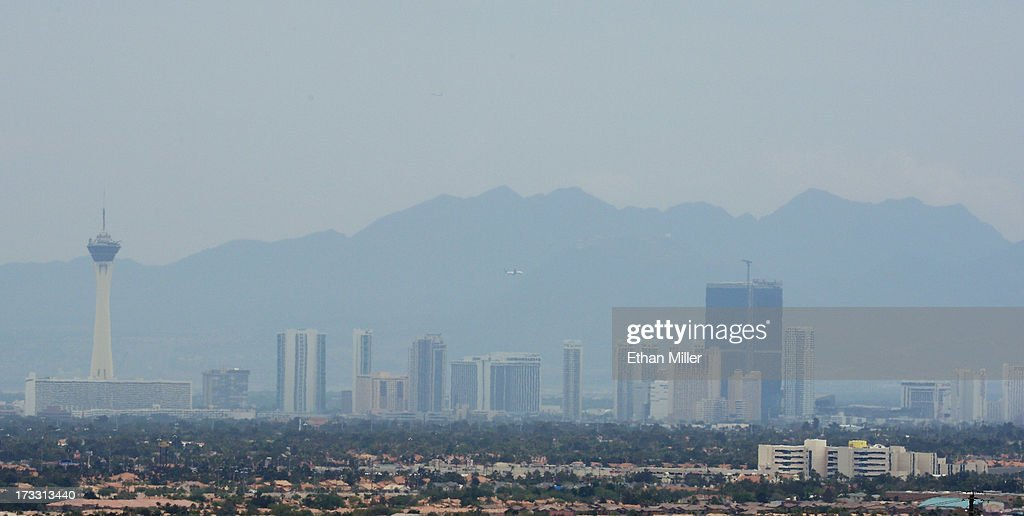 Drift smoke from the Carpenter 1 fire in the Spring Mountains range partially obscures the view of hotel-casinos on the Las Vegas Strip as seen from the incident command post for the fire on July 11, 2013 in Las Vegas, Nevada. Nearly 28,000 acres have burned since lightning sparked the blaze in Carpenter Canyon on the Pahrump, Nevada side of Mount Charleston on July 1. More than 1,200 fire personnel are battling the wildfire which crested the peak of Mount Charleston on July 4, prompting the evacuation of 520 people as it began descending the east side of the mountain, about 35 miles northwest of Las Vegas. Lower temperatures, higher humidity and some rainfall on Thursday are helping fire crews gain ground on the fire which is now 15% contained; fire officials estimate that they won't have it fully contained until July 19.