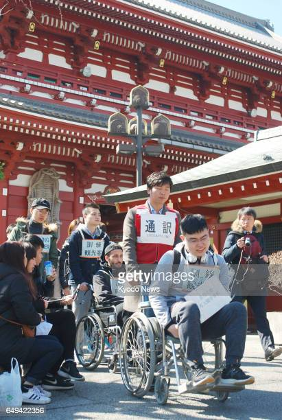 A drill in evacuating foreign tourists after a major earthquake is held at the Sensoji temple in Tokyo on March 8 ahead of the sixth anniversary of...