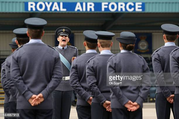 A drill instructor orders Royal Air Force personnel to practice their drills in the parade ground at RAF Halton ahead of formal duties to celebrate...