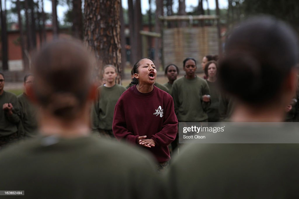 Drill Instructor Sgt. Adrienne Cambridge speaks to her female Marine recruits during boot camp February 27, 2013 at MCRD Parris Island, South Carolina. Female enlisted Marines have gone through recruit training at the base since 1949. About 11 percent of female recruits who arrive at the boot camp fail to complete the training, which can be physically and mentally demanding. On January 24, 2013 Secretary of Defense Leon Panetta rescinded an order, which had been in place since 1994, that restricted women from being attached to ground combat units. About six percent of enlisted Marines are female.
