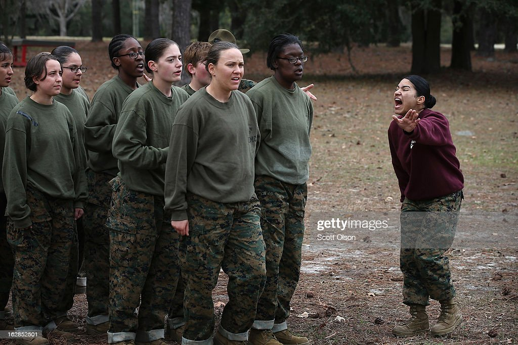 A drill instructor shouts instructions at her Marine recruits during training in boot camp February 27, 2013 at MCRD Parris Island, South Carolina. Female enlisted Marines have gone through recruit training at the base since 1949. About 11 percent of female recruits who arrive at the boot camp fail to complete the training, which can be physically and mentally demanding. On January 24, 2013 Secretary of Defense Leon Panetta rescinded an order, which had been in place since 1994, that restricted women from being attached to ground combat units. About six percent of enlisted Marines are female.