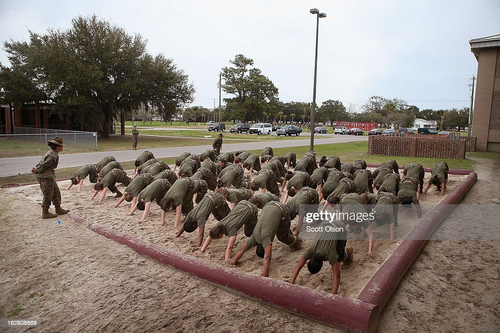 Drill Instructor SSgt Jennifer Garza of Kerrville Texas disciplines her Marine recruits with some unscheduled physical training in the sand pit...