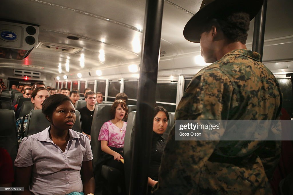 Drill Instructor SSgt. Latoya Moffett of Ocilla, Georgia shouts orders at male and female Marine recruits arriving by bus for boot camp on February 25, 2013 at MCRD Parris Island, South Carolina. Female enlisted Marines have gone through recruit training at the base since 1949. About 11 percent of female recruits who arrive at the boot camp fail to complete the training, which can be physically and mentally demanding. On January 24, 2013 Secretary of Defense Leon Panetta rescinded an order, which had been in place since 1994, that restricted women from being attached to ground combat units.