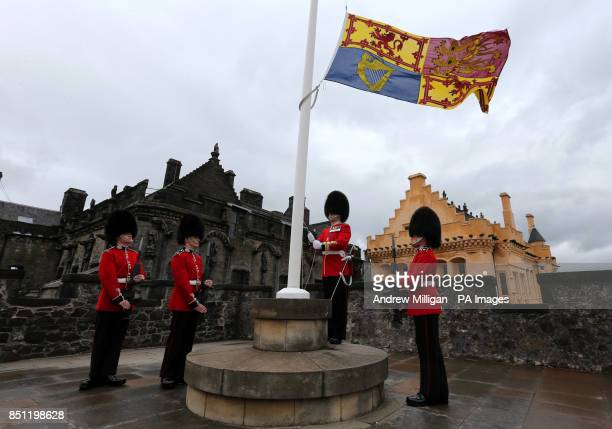 Drill Seargant John Lilley raises the Royal Standard at Stirling Castle Castle Guards as Gunners from the 105th Regimental Royal Artillery fired a 21...