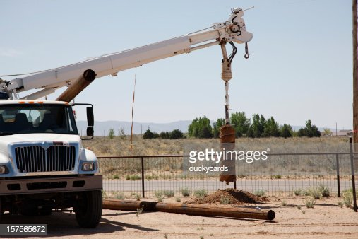 Drilling a Hole for Utility Pole with an Auger