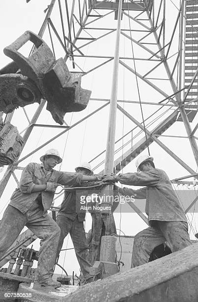 Drilling an oil well on the Manchurian Steppe