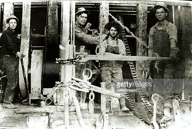 A drilling crew takes a break atop Spindletop Hill in Beaumont Texas where the first Texas oil gusher was discovered January 10 1901 Beaumont in the...