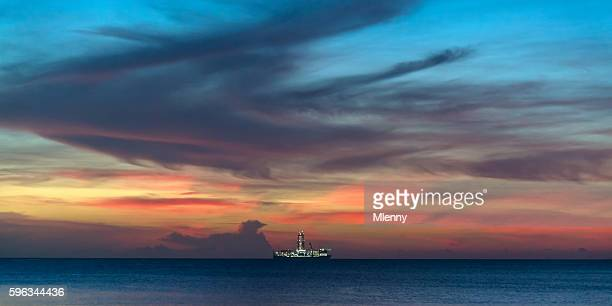 Drillship illuminated under amazing colorful twilight skyscape