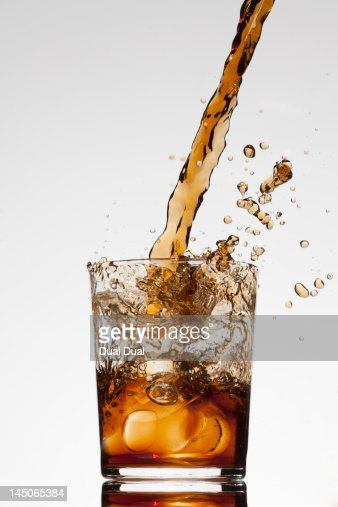 A drink being poured into a glass