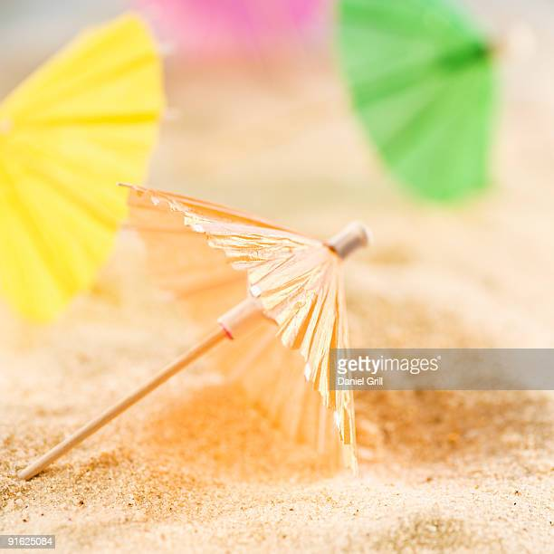 Drink umbrellas on sand