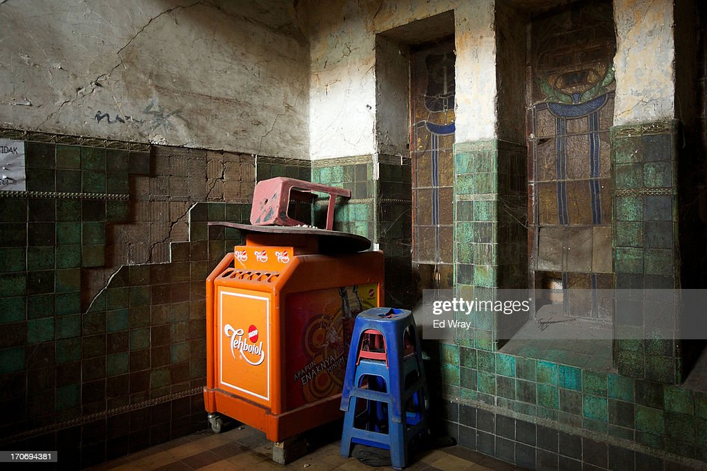A drink vendor's equipment is stored in the ruins of an old dutch building in Kota Tua Sunday June 16, 2013 in Jakarta, Indonesia. Once known as the 'Queen of the East', Kota Tua, which means Old Town in Indonesian, is the original city of Jakarta built by the Dutch in the 16th century and called Batavia at that time. Currently, Kota Tua's beautiful Colonial architecture is in ruins, abandoned as the city edged farther south over the years. Jakarta's Governor, Joko Widodo, hopes to make it a priority to restore the old town and develop it into a high end tourist destination..