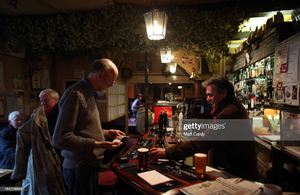 A drinker is served a pint inside the Bell Inn in Walcot Street on March 21, 2013 in Bath, England. Customers of the popular music venue have raised 720,000 GBP to buy the pub from its current owner in a campaign to save it, which has been backed by rock stars including Robert Plant and Peter Gabriel. When the pub was put up for sale, customers launched a buyout with shares priced from 500 GBP to 20,000 GBP to initially raise 500,000 GBP with a loan to cover the shortfall in the asking price of 925,000 GBP.