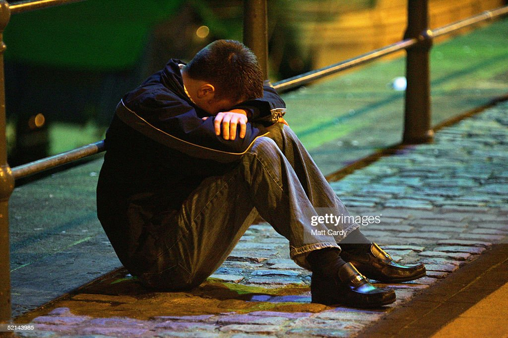 A drinker turned away from a club for appearing to be too drunk sits on the floor February 5 2005 in Bristol England This weekend was the last one...