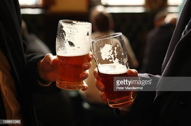 Drinkers enjoy a pint in a pub on March 11 2011 in London England