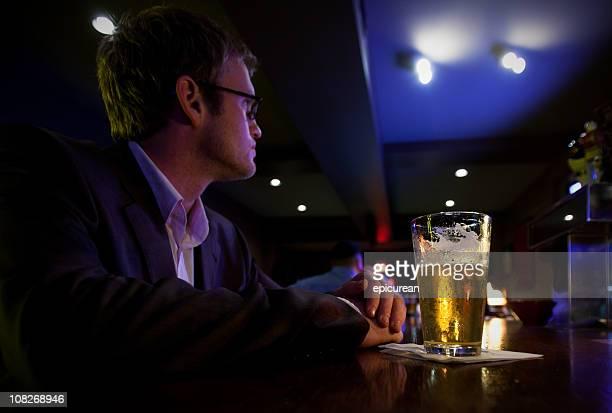 Drinking alone at a bar