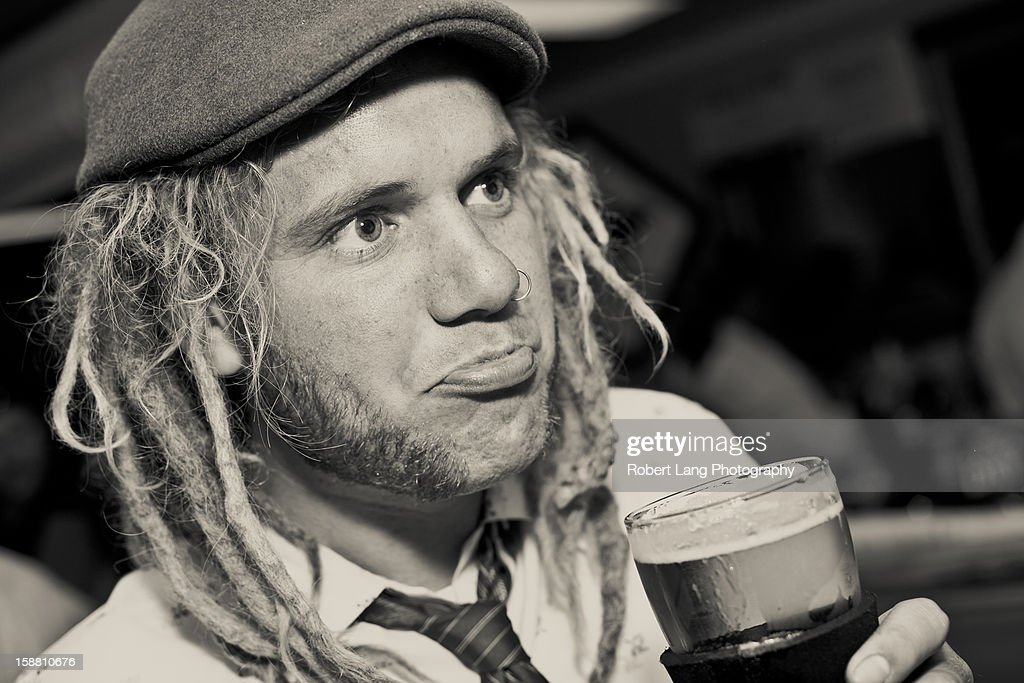Drinking beer at a pub : Stock Photo