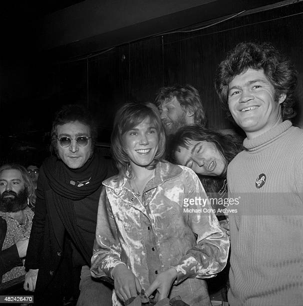 Drinking buddies known as 'The Hollywood Vampires' LR John Lennon Harry Nilsson Alice Cooper and Micky Dolenz celebrate an early Thanksgiving with...
