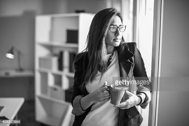 Drinking coffee in black and white