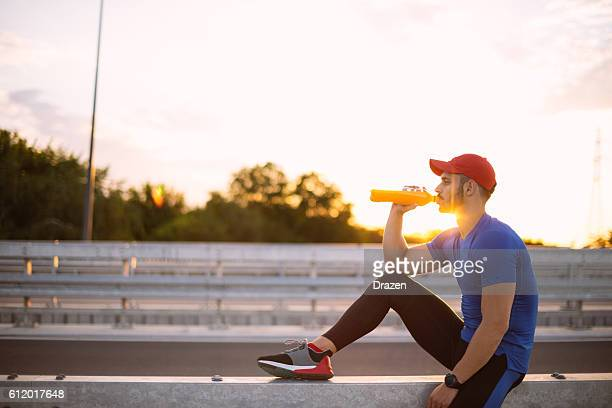 Drinking energy drink after training