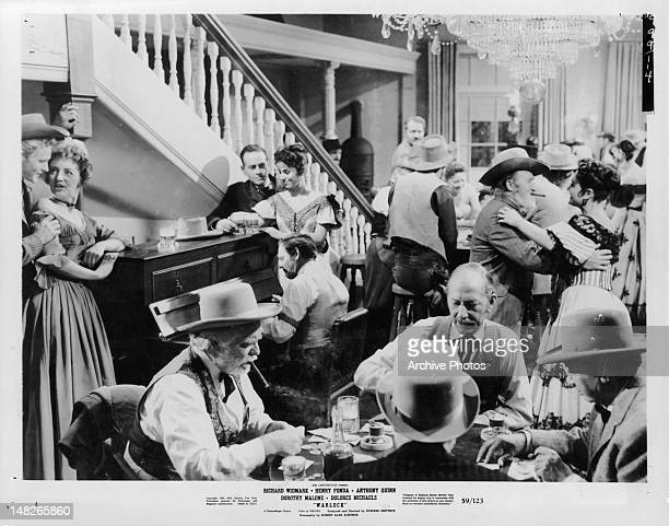 Drinking gambling and dancing in a scene from the film 'Warlock' 1959