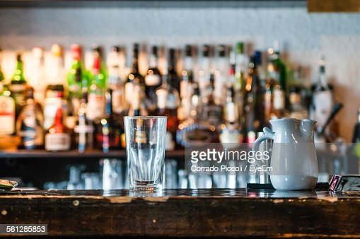 Drinking Glass And Jar On Bar Counter