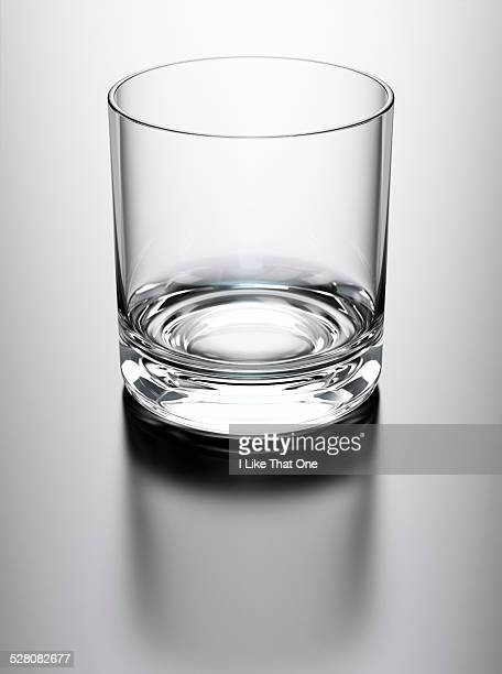 Drinking glass sat on a reflective surface