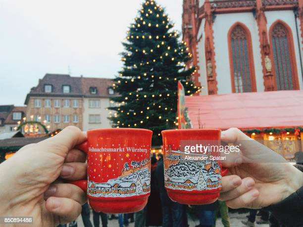 Drinking gluhwein (mulled wine) at Christmas market in Germany