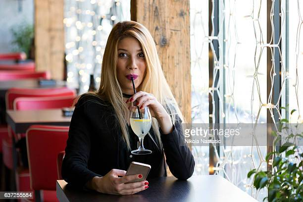 Drinking lemonade and texting