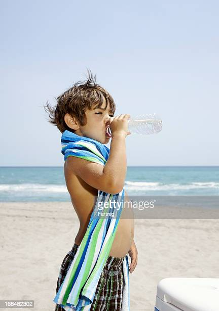 Drinking water at the beach