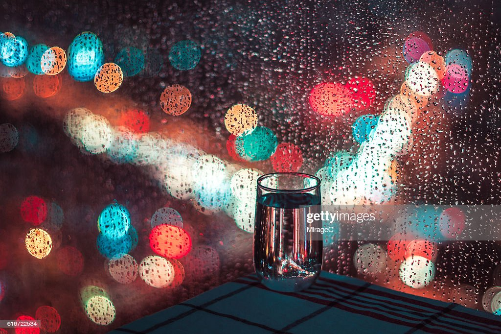 Drinking Water in Rainy Night, Relax : Stock Photo