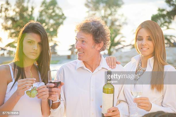 Drinking wine at party