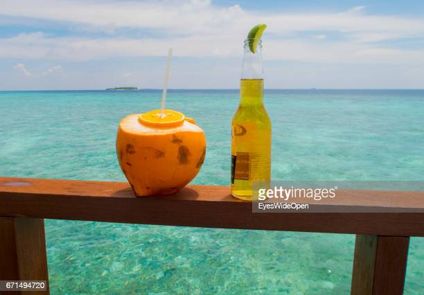Drinks a Coconut and a Beer at the Bar facing turquois Waters at Coco Bodu Hiti NorthMaleAtoll on February 26 2017 in Male Maldives