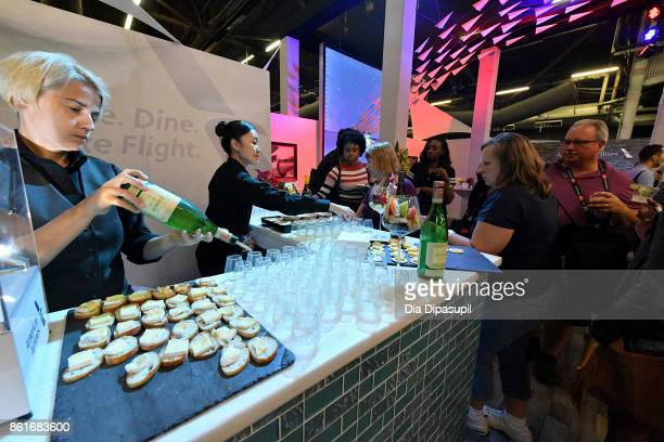 Drinks are served at the Food Network Cooking Channel New York City Wine Food Festival Presented By CocaCola Grand Tasting presented by ShopRite...