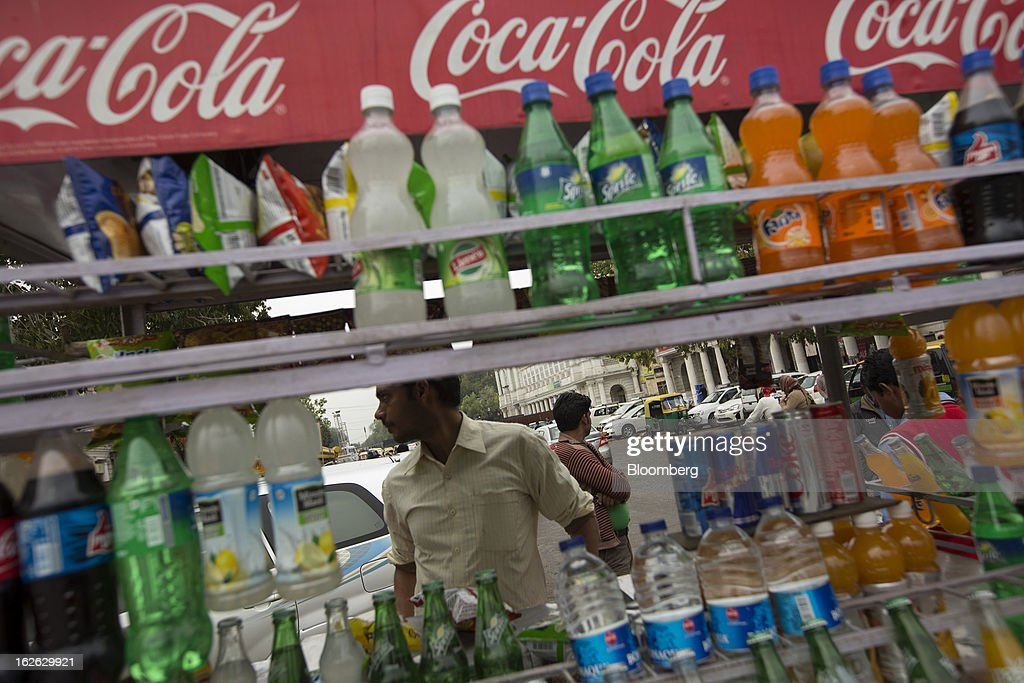 Drinks are sold at a Coca-Cola branded stall in Connaught Place in New Delhi, India, on Saturday, Feb. 23, 2013. Finance Minister Palaniappan Chidambaram, who will present his annual budget to parliament on Feb. 28, will seek to narrow the shortfall to 4.8 percent of gross domestic product in the year starting April, from this year's goal of 5.3 percent, according to a Bloomberg survey of analysts and investors. Photographer: Brent Lewin/Bloomberg via Getty Images