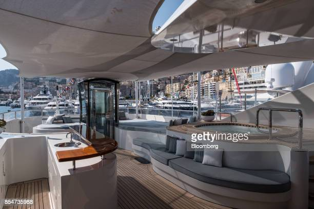 A drinks bar and jaccuzzi sit on the deck of Latitude manufactured by Azimut Benetti SpA during the Monaco Yacht Show in Port Hercules Monaco on...