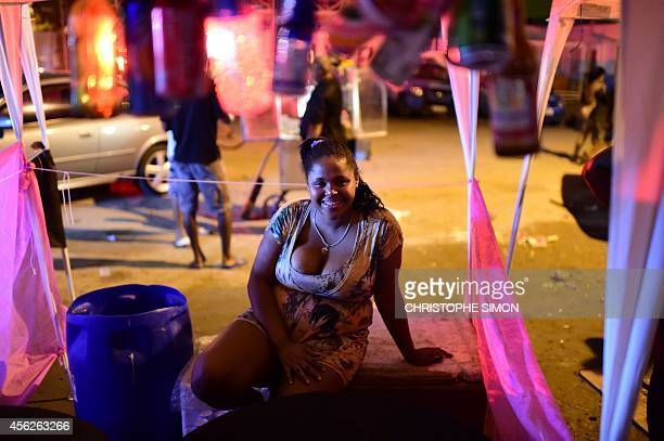 A drinks seller watches the BrazilianFrench 'Planeta Ginga' film and music free festival at the Cidade de Deus shantytown in Rio de Janeiro Brazil on...