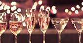 Close up of wine, martini and champagne glasses against beautiful bokeh.