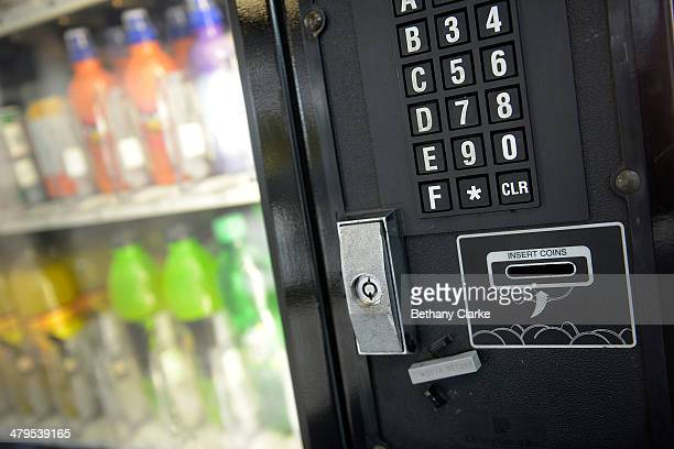 A drinks vending machine accepts coins on March 19 2014 in London England Plans have been announced by the Bank of England to replace the current one...