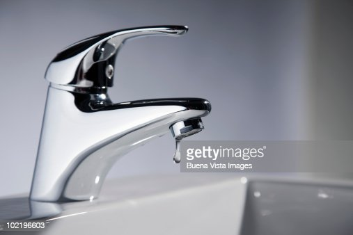 Dripping faucet : Stock Photo