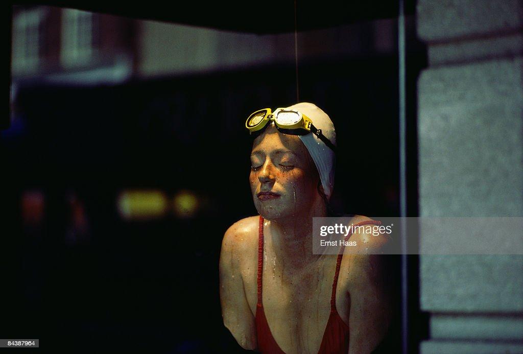 Premium Rates Apply. A female swimmer, June 1981.